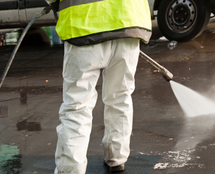 Grease spill clean up with water recovery. Pumping grease out of a parking lot. Oil spill clean up street.  Overspills of grease traps and interceptor can be caused by many different factors such as lack of maintenance of the grease trap or interceptor or the plumbing.
