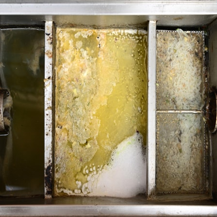 Grease trap cleaning service. Pumping and cleaning restaurant grease.